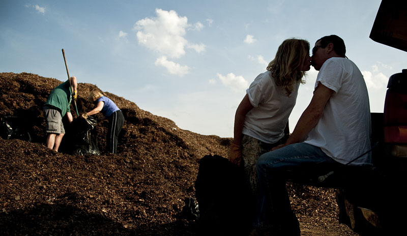 Friends help Sheryl bag mulch from the counties local leaf dump while Sheryl takes a break to keep Keith smiling.